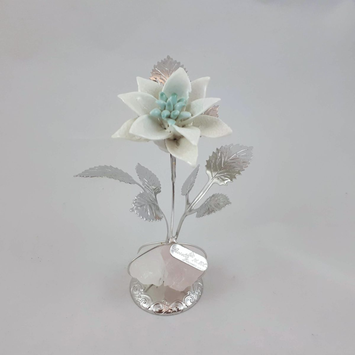 Stella Di Natale Bianca.Stella Di Natale In Argento E Porcellana Bianca Su Quarzo Rosa